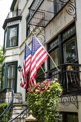 Two American Flags on Old Classic Home