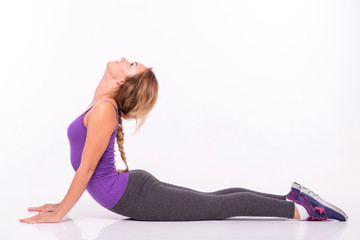 Healthy young sportswoman does the exercises
