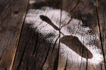 Imprint spoon made of sugar on table