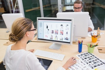 Photo editors using computers in office