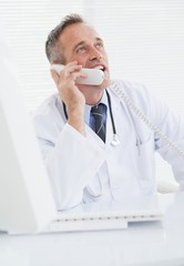 Smiling doctor answering a call