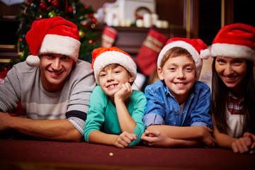 Family in Santa caps