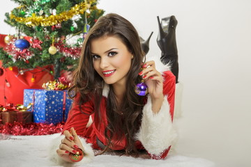 Smiling pretty woman, Christmas tree, decorations and baubles