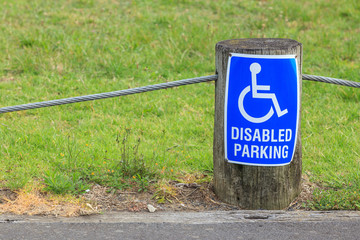 Disabled parking sign for persons with disabilities, for providi