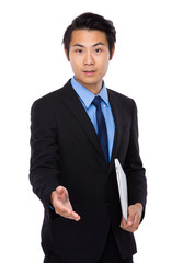 Businessman with laptop and handshake with other