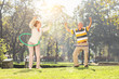 Mature couple exercising with hula hoops in park