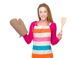 Housewife with gloves and spatula