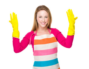 Housewife hand with kitchen gloves