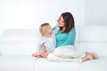 mom and daughter on white background