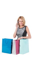 young pretty woman posing with  shopping bags