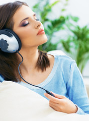 Music woman. Girl listening music with headphones.