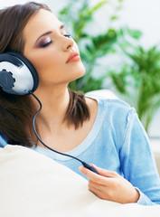 Music woman. Girl listening music with headphones.
