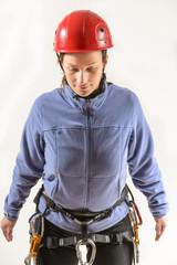 Woman wearing climbing equipment