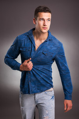Handsome male model on gray background