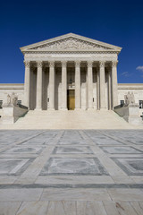 Supreme courthouse in Washington, blue sky behind.
