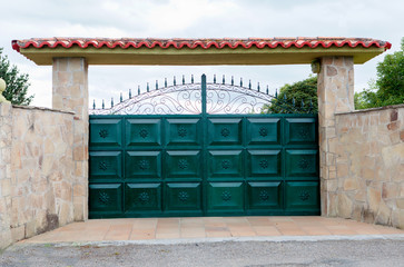 Iron gate with stone wall