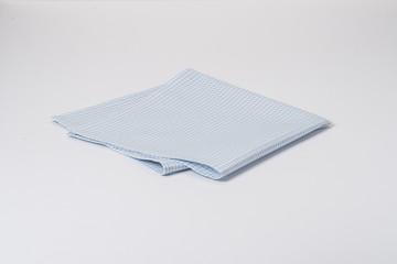 Folded Gingham Cotton Napkin On White Background