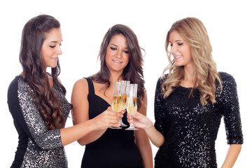Three friends with sparkling dresses toasting