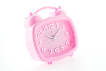 Pink clock isolated on white background