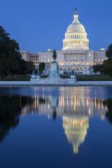 The Capitol building in Washington D,C illuminated at night.