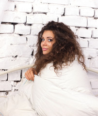 young woman   under duvet