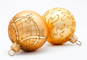 Two golden christmas balls isolated