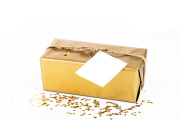 Golden gift box with blank card