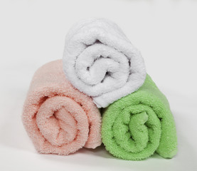 three rolled towels, isolated on white background