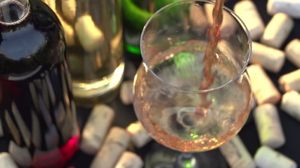 Pink Wine is Poured into a Glass