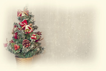 small christmas tree with snowfall background and white border