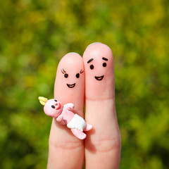 Finger art of Happy couple. Happy family holding small child