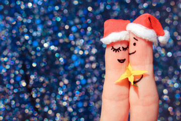 Finger art of Happy couple. Man is giving flowers to woman