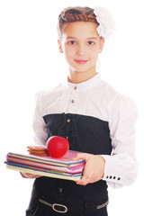 Girl in school uniform holding a book in his hand