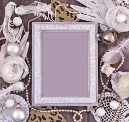 Christmas frame with vintage ornaments and women's white gloves