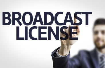 Business man pointing the text: Broadcast License