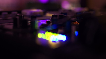 DJ Mixing board with blue and green lights