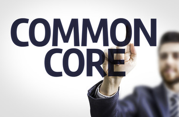 Business man pointing the text: Common Core