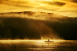 Fototapeta Early morning sunrise, boating on the lake in the sunlight