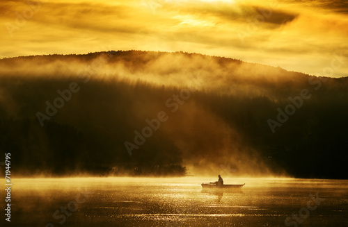 canvas print picture Early morning sunrise, boating on the lake in the sunlight