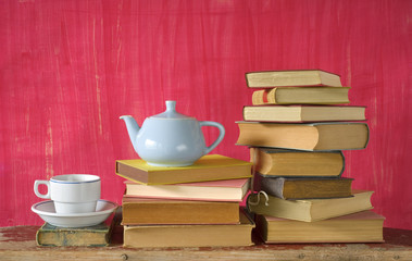 books with cup of coffee and a coffee pot, free copy space