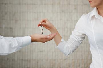Man and woman hand passing keys