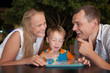 Happy family with tablet PC outdoor in the evening