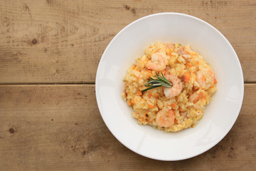 Risotto with shrimps, prosciutto and various vegetables
