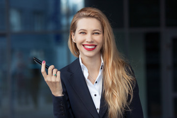 portrait of a business woman with a pen on the background of the