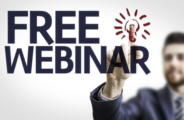 Business man pointing the text: Free Webinar
