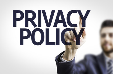 Business man pointing the text: Privacy Policy