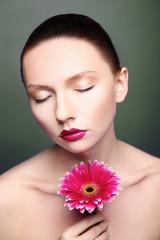beauty woman portrait bright backround holding gerbera