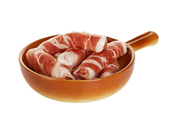 sausages wrapped in bacon in a frying pan