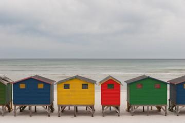 Brightly coloured beach huts 2