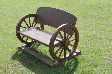 A Wooden Seat Made Using Old Cart Wheels.